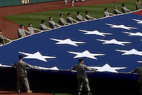 Members of the of the 56th Brigade of the Pennsylvania National Guard unfurl the American flag on opening day of the Philadelphia Phillies homer opener against Atlanta Braves Monday, April 2, 2007, in Philadelphia. (Bradley C Bower/Bloomberg News)