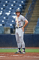 Lakeland Flying Tigers center fielder Cam Gibson (12) tries to keep his bat handle dry as it begins to rain heavily just before a delay during the first game of a doubleheader against the Tampa Tarpons on May 31, 2018 at George M. Steinbrenner Field in Tampa, Florida.  Tampa defeated Lakeland 3-0.  (Mike Janes/Four Seam Images)
