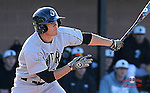 Right fielder Josh Hyman (22) of the Wofford Terriers hits in a game against the USC Upstate Spartans on Wednesday, March 27, 2013, at Cleveland S. Harley Park in Spartanburg, South Carolina. Wofford won, 12-11.(Tom Priddy/Four Seam Images)