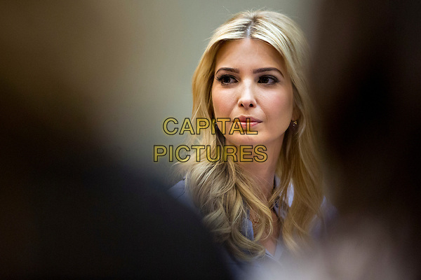 Ivanka Trump, daughter of U.S. President Donald Trump, listens while meeting with women small business owners with Trump, not pictured, in the Roosevelt Room of the White House in Washington, D.C., U.S., on Monday, March 27, 2017.  Investors on Monday further unwound trades initiated in November resting on the idea that the election of Trump and a Republican Congress meant smooth passage of an agenda that featured business-friendly tax cuts and regulatory changes. <br /> CAP/MPI/CNP/RS<br /> ©RS/CNP/MPI/Capital Pictures