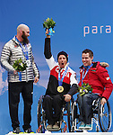 Sochi, Russia.15/03/2014- Canadian Josh Dueck celebrates his gold medal in the mens super combined sit skiing with silver medalist Heath Calhoun from the United States and Bronze medalist Roman Rabl from Austria,during the 2014 Paralympic Games in Sochi, Russia.Photo(Scott Grant/Canadian Paralympic Committee