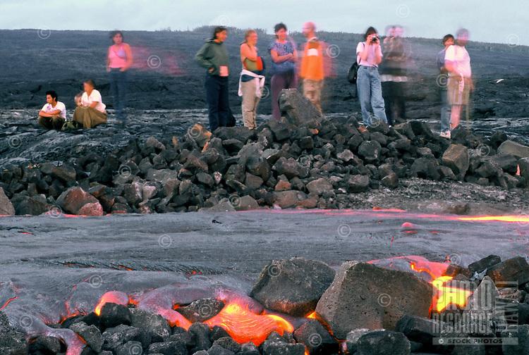 Spectators watch as new lava flows from Kilauea volcano, Hawaii volcanoes national park, Big Island