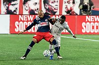 FOXBOROUGH, MA - NOVEMBER 20: Teal Bunbury #10 of New England Revolution attempts to control the ball as Mason Toye #13 of Montreal Impact defends during the Audi 2020 MLS Cup Playoffs, Eastern Conference Play-In Round game between Montreal Impact and New England Revolution at Gillette Stadium on November 20, 2020 in Foxborough, Massachusetts.