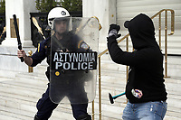 Pictured: A protester attacks a riot police officer with a hammer Wednesday 17 May 2017<br /> Re: Clashes between anti fourth memorandum protesters and riot police during 24 hour strike in Athens, Greece