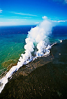 aerial view of lava ocean entry - hot molten lava fed from multiple underground lava tubes, creating massive steam clouds as it enters cold ocean, Hawaii Volcanoes National Park, Kilauea, Big Island, Hawaii, USA, Pacific Ocean