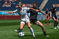 BRIDGEVIEW, IL - JUNE 5: Kristen Hamilton #23 of the North Carolina Courage plays the ball as Arin Wright #3 of the Chicago Red Stars defends during a game between North Carolina Courage and Chicago Red Stars at SeatGeek Stadium on June 5, 2021 in Bridgeview, Illinois.