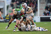 Joe Marler of Harlequins is tackled by Mat Gilbert of Bath Rugby during the Aviva Premiership match between Harlequins and Bath Rugby at the Twickenham Stoop on Saturday 13th April 2013 (Photo by Rob Munro)
