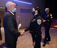 Rep. Steve Womack (from left) speaks Thursday, April 1, 2021, with Natalie Eucce and Seay Floyd, both officers with the Fayetteville Police Department, before awarding them with the Attorney General's Award for Distinguished Service in Policing for their actions after the killing of fellow officer Stephen Carr Dec. 7, 2019. Womack made the presentation during a ceremony at the Fayetteville Public Library before touring the library's newly opened addition. Visit nwaonline.com/210402Daily/ for today's photo gallery. <br /> (NWA Democrat-Gazette/Andy Shupe)