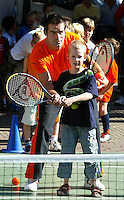 21-9-06,Leiden, Tennis, training Daviscup, Lead player Raemon Sluiter helping a younster play at the streettennis event ptior to the draw