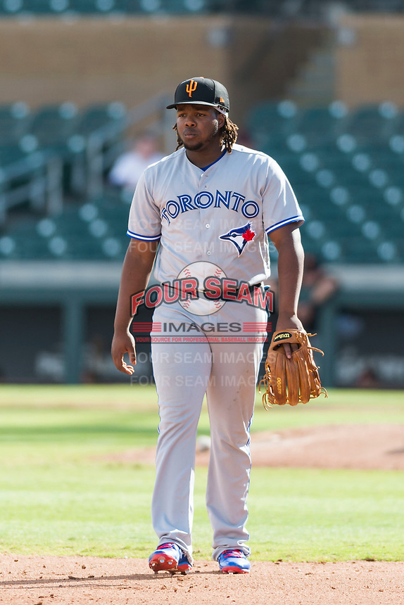Surprise Saguaros third baseman Vladimir Guerrero Jr. (27), of the Toronto Blue Jays organization, during an Arizona Fall League game against the Salt River Rafters at Salt River Fields at Talking Stick on October 23, 2018 in Scottsdale, Arizona. Salt River defeated Surprise 7-5 . (Zachary Lucy/Four Seam Images)
