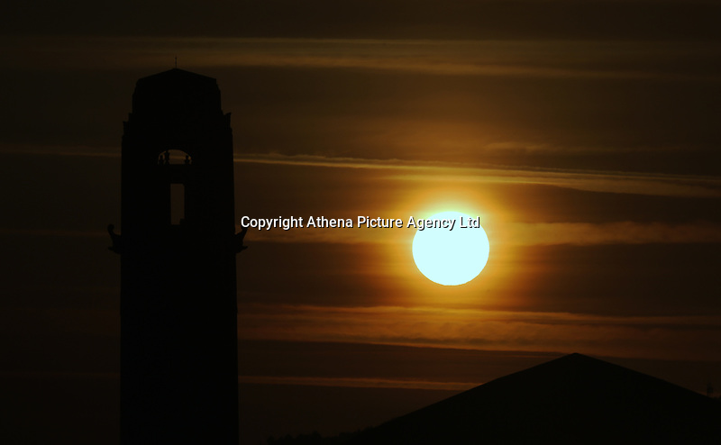 Pictured: The sun rises over the clock tower of the Guild Hall in Swansea, south Wales, UK. Wednesday 21 June 2017<br /> Re: Summer Solstice