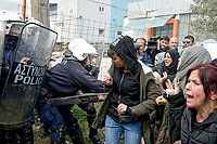 Pictured: Migrants clash against riot police in Diavata, Greece. Friday 05 April 2019<br /> Re: Clashes between migrants and riot police have broken out at the former Anagnostopoulos army camp, after rumours started spreading that the borders had re-opened, in Diavata near Thessaloniki, Greece