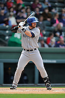 Infielder Brian Mundell (15) of the Asheville Tourists bats in a game against the Greenville Drive on Sunday, April 10, 2016, at Fluor Field at the West End in Greenville, South Carolina. Greenville won, 7-4. (Tom Priddy/Four Seam Images)