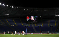 Players enter the pitch as the scoreboard broadcasts a picture of the Italian composer and Oscar wawarded Ennio Morricone, who died on last July 6, prior to the start of the Italian Serie A football match between Roma and Parma at Rome's Olympic stadium, July 8, 2020.<br /> UPDATE IMAGES PRESS/Isabella Bonotto