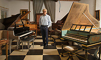 BNPS.co.uk (01202) 558833<br /> Pic: ZacharyCulpin/BNPS<br /> <br /> Pictured: David Winston with the collection<br /> <br /> A remarkable collection of rare pianos belonging to the Queen's personal restorer and conservator has emerged for sale for £250,000.<br /> <br /> David Winston is parting with 26 pianos he has amassed over the past 30 years dating from the 18th century to the present day.<br /> <br /> Mr Winston, who was awarded the Royal Warrant in 2012, is regarded as one of the foremost experts in his field and has restored pianos owned and played by Beethoven, Chopin and Liszt.<br /> <br /> His collection includes a 1925 Pleyel grand piano fitted with an original 'Auto Pleyela' self-playing mechanism in a spectacular Chinoiserie Louis XV case valued at 60,000.