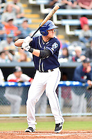 Asheville Tourists designated hitter Pat Valaika #16 awaits a pitch during a game against the  Greenville Drive at McCormick Field on May 17, 2014 in Asheville, North Carolina. The Tourists defeated the Drive 14-6. (Tony Farlow/Four Seam Images)