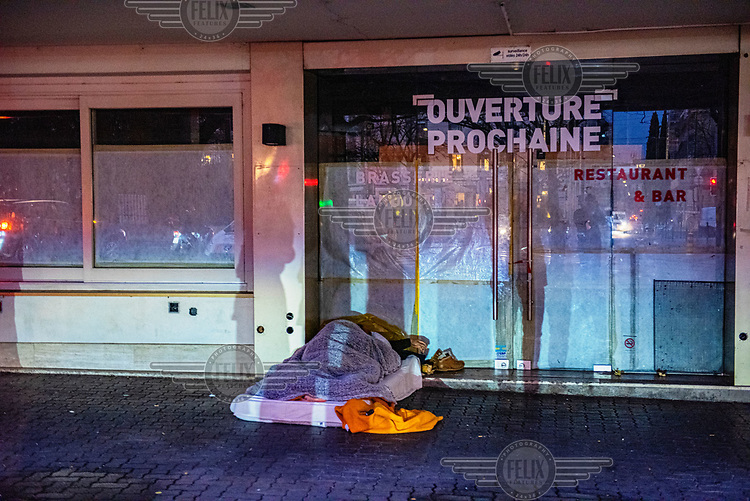 Romanians sleeping rough in sub-zero temperatures outside a restaurant closed for renovations.