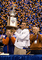 01 January 2010:  Florida head coach Urban Meyer holds up Sugar Bowl Championship trophy after winning the game against Cincinnati during Sugar Bowl at the SuperDome in New Orleans, Louisiana.  Florida defeated Cincinnati, 51-24.