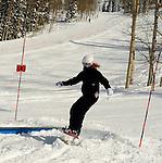 Snowboarder Emma Shapera on a sunny powder dayat Grand Targhee Resort, Wyoming
