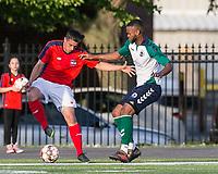 Malden, Massachusetts - June 9, 2018:  In a National Premier Soccer League (NPSL) match, Boston City FC (red/white) defeated Hartford City FC (white/green/blue), 2-0, at Brother Gilbert Stadium on Donovan Field.