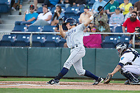 Robbie Perkins #9 of the Tri-City Dust Devils at bat during a game against the Everett AquaSox at Everett Memorial Stadium in Everett, Washington on July 28, 2014. Tri-City defeated Everett 6-5 in 11 innings.  (Ronnie Allen/Four Seam Images)
