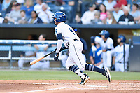 Asheville Tourists Cade Harris (4) swings at a pitch during a game against the Lakewood BlueClaws at McCormick Field on June 14, 2019 in Asheville, North Carolina. The BlueClaws defeated the Tourists 7-5. (Tony Farlow/Four Seam Images)