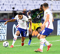 DALLAS, TX - JULY 25: Reggie Cannon #2 of the United States and Shamar Nicholson #11 of Jamaica battle for control of the ball during a game between Jamaica and USMNT at AT&T Stadium on July 25, 2021 in Dallas, Texas.