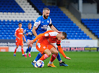 Blackpool's Jerry Yates vies for possession with Peterborough United's Dan Butler<br /> <br /> Photographer Chris Vaughan/CameraSport<br /> <br /> The EFL Sky Bet League One - Peterborough United v Blackpool - Saturday 21st November 2020 - London Road Stadium - Peterborough<br /> <br /> World Copyright © 2020 CameraSport. All rights reserved. 43 Linden Ave. Countesthorpe. Leicester. England. LE8 5PG - Tel: +44 (0) 116 277 4147 - admin@camerasport.com - www.camerasport.com