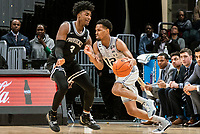 WASHINGTON, DC - FEBRUARY 19: Terrell Allen #12 of Georgetown pushes past David Duke #3 of Providence during a game between Providence and Georgetown at Capital One Arena on February 19, 2020 in Washington, DC.