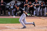 Lansing Lugnuts shortstop Kevin Smith (4) swings at a pitch during a Midwest League game against the Wisconsin Timber Rattlers on May 8, 2018 at Fox Cities Stadium in Appleton, Wisconsin. Lansing defeated Wisconsin 11-4. (Brad Krause/Four Seam Images)