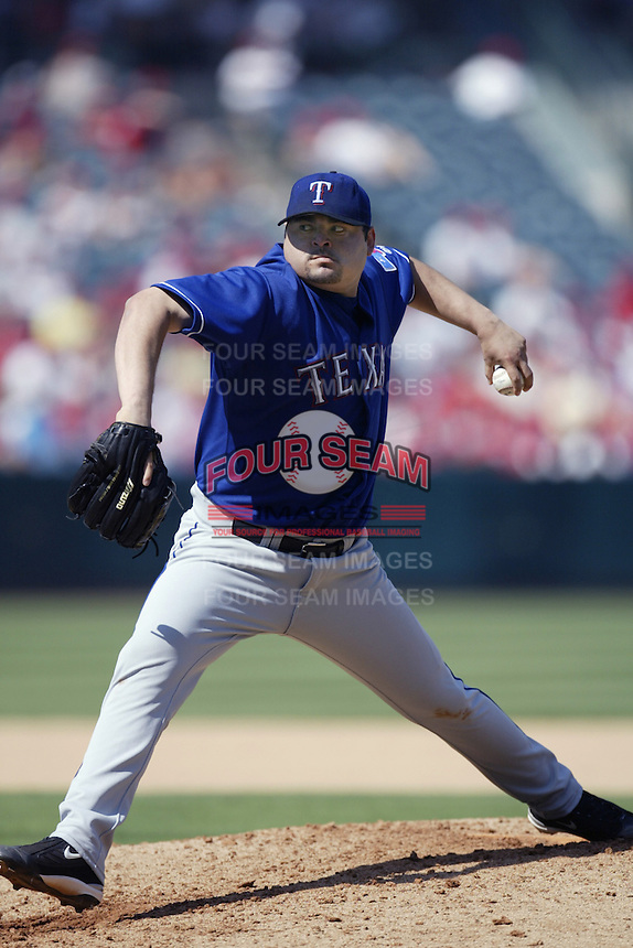 Dennys Reyes of the Texas Rangers pitches during a 2002 MLB season game against the Los Angeles Angels at Angel Stadium, in Los Angeles, California. (Larry Goren/Four Seam Images)