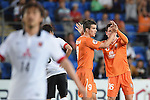 Andrija Kaluderovic of Brisbane Roar celebrates scoring a goal with Devante Clut (R) during the 2015 AFC Champions League match between the Brisbane Roar and the Urawa Red Diamonds on Tuesday, 5 May 2015 on the Gold Coast, Queensland, Australia. Photo by Matt Roberts / World Sport Group