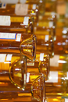 Golden yellow bottles of sweet white Bergerac and Monbazillac wine on display at the Maison de Vin in Bergerac, the House of Wine Bergerac Dordogne France
