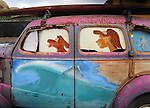 The old rusted out Woody is displayed outside a surf shop in Oahu, Hawaii.