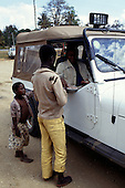 Mikumi, Tanzania. Local children selling peanuts to tourist in a four wheel drive jeep.