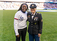 HARRISON, NJ - MARCH 08: Semahj Ware, the SheBelieves Hero, stands on the field with a member of the military during a game between Spain and USWNT at Red Bull Arena on March 08, 2020 in Harrison, New Jersey.