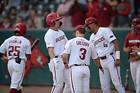 Arkansas right fielder Cayden Wallace is congratulated at the dugout entrance Tuesday, April 6, 2021, by left fielder Zack Gregory (3) and shortstop Jalen Battles (4) after hitting a solo home run during the first inning of play against UALR at Baum-Walker Stadium in Fayetteville. Visit nwaonline.com/210407Daily/ for today's photo gallery. <br /> (NWA Democrat-Gazette/Andy Shupe)