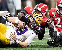 ATLANTA, GA - DECEMBER 7: Malik Herring #10 of the Georgia Bulldogs tackles Joe Burrow #9 of the LSU Tigers during a game between Georgia Bulldogs and LSU Tigers at Mercedes Benz Stadium on December 7, 2019 in Atlanta, Georgia.