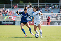CARY, NC - SEPTEMBER 12: Carson Pickett #4 of the NC Courage defends against Rocky Rodriguez #11 of the Portland Thorns during a game between Portland Thorns FC and North Carolina Courage at Sahlen's Stadium at WakeMed Soccer Park on September 12, 2021 in Cary, North Carolina.