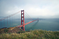 Fog sets over San Francisco with Golden Gate Bridge in foreground