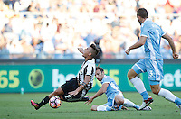 Calcio, Serie A: Lazio vs Juventus. Roma, stadio Olimpico, 27 agosto 2016.<br /> Juventus' Paulo Dybala, left, is tackled by Lazio's Stefan Radu, center, during the Serie A soccer match between Lazio and Juventus, at Rome's Olympic stadium, 27 August 2016. Juventus won 1-0.<br /> UPDATE IMAGES PRESS/Isabella Bonotto