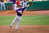 LSU Tigers third baseman Tyler Hanover #11 leaps for a line drive during the NCAA Super Regional baseball game against Stony Brook on June 9, 2012 at Alex Box Stadium in Baton Rouge, Louisiana. Stony Brook defeated LSU 3-1. (Andrew Woolley/Four Seam Images)