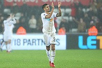 Kyle Naughton of Swansea applauds the fans after the final whistle of during the Premier League match between Swansea City and Arsenal at the Liberty Stadium, Swansea, Wales, UK. Tuesday 30 January 2018
