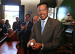 Gov. Brian Sandoval shows off the first medallion at a ceremony marking the beginning of production of the fourth and final medallion in a commemorative Sesquicentennial series at the Nevada State Museum, in Carson City, Nev., on Wednesday, Sept. 3, 2014. <br /> Photo by Cathleen Allison
