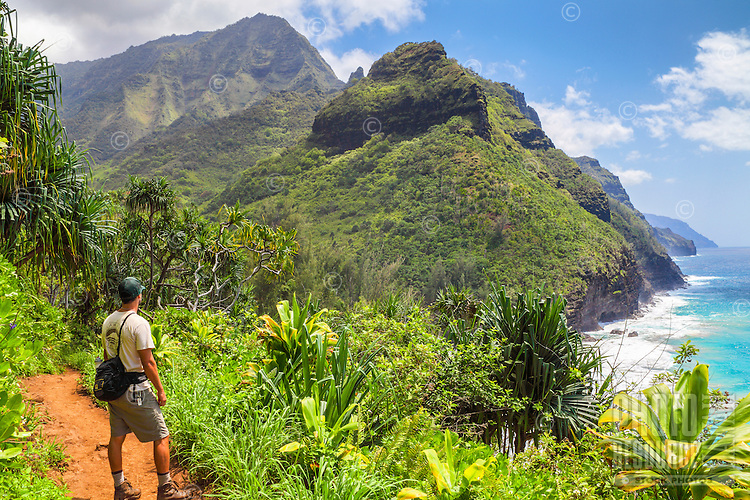 A state park ranger pauses while hiking the Kalalau Trail near Hanakapi'ai Beach, North Kaua'i.