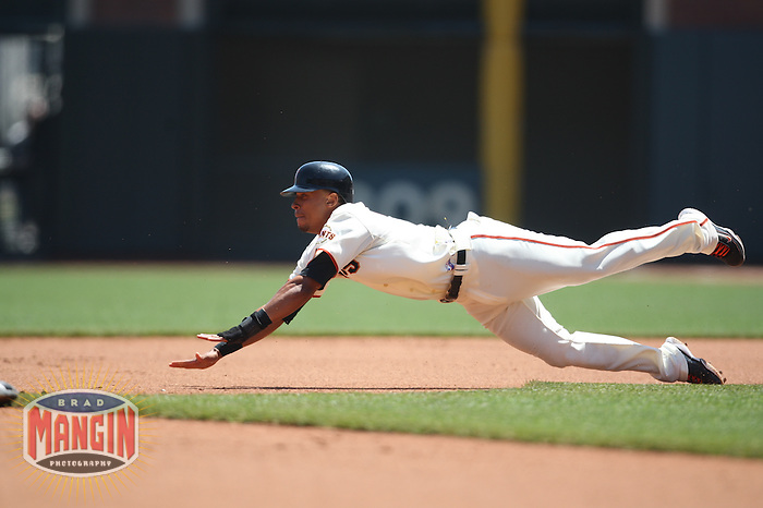 SAN FRANCISCO - APRIL 22:  Emmanuel Burriss #7 of the San Francisco Giants dives safely into second base for a stolen base against the San Diego Padres during the game at AT&T Park on April 22, 2009 in San Francisco, California. Photo by Brad Mangin