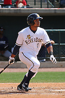 Zoilo Almonte #7 of the Charleston RiverDogs hitting during a game against the Rome Braves on April 27, 2010  in Charleston, SC.