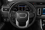 Car pictures of steering wheel view of a 2021 GMC Yukon-Denali - 5 Door SUV Steering Wheel