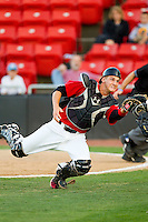 Catcher Kellin Deglan #15 of the Hickory Crawdads chases after a foul pop fly against the Augusta GreenJackets at L.P. Frans Stadium on April 29, 2011 in Hickory, North Carolina.   Photo by Brian Westerholt / Four Seam Images