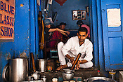 Chanchal Yadav poses for a photo while preparing lassi (yogurt drink) in his shop, The Blue Lassi that is quite a hit with the korean tourists in the ancient city of Varanasi in Uttar Pradesh, India. Photograph: Sanjit Das/Panos